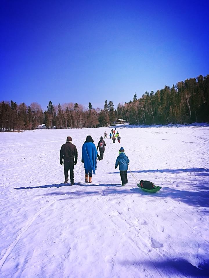 Actors and children walking on frozen lake
