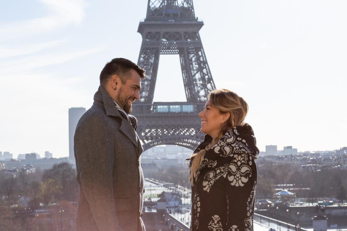 Photo of Chelsey and Jaaji in front of the Eiffel Tower