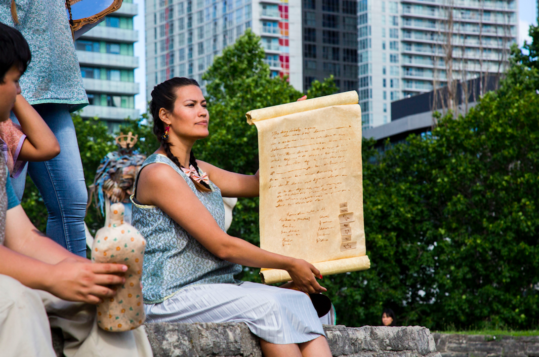 Actor holds treaty prop during Talking Treaties