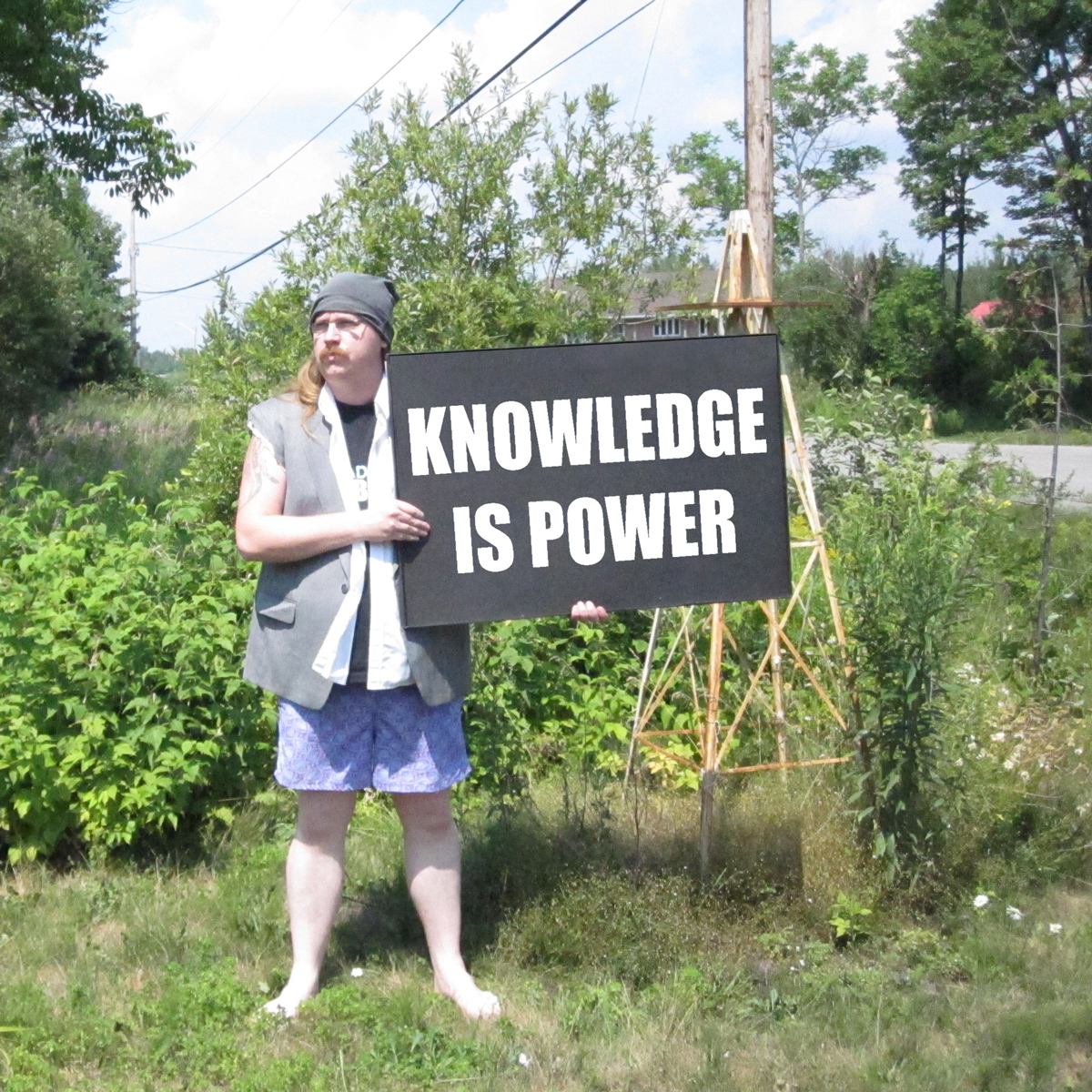 Clayton Windatt holding Knowledge is Power sign